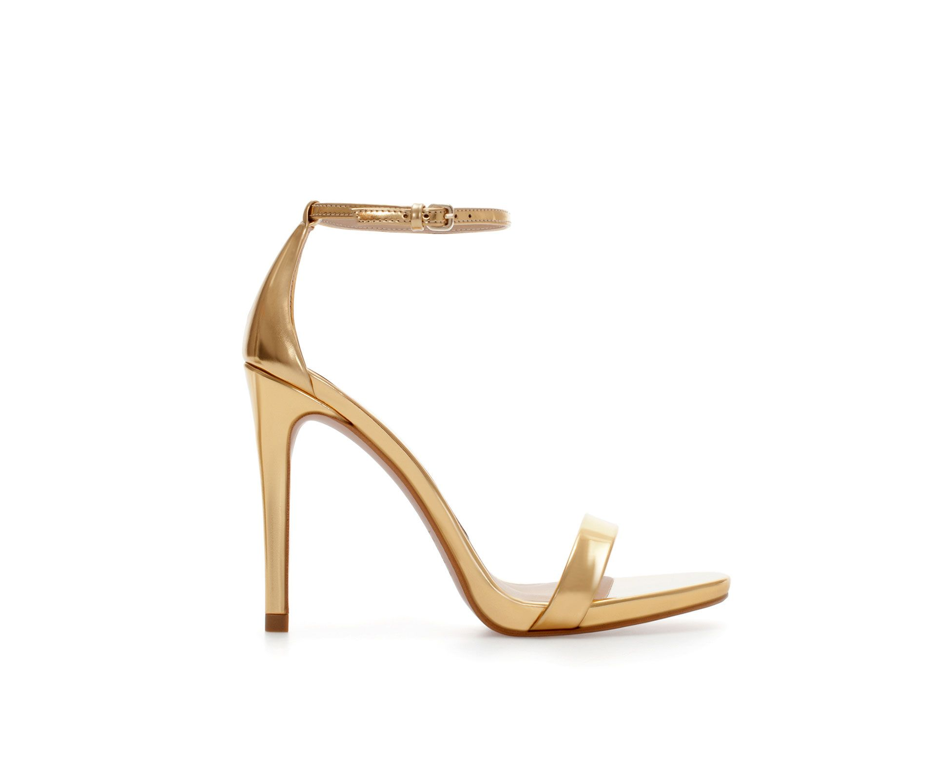 Gold high heel strappy sandals from Zara´s new collection.
