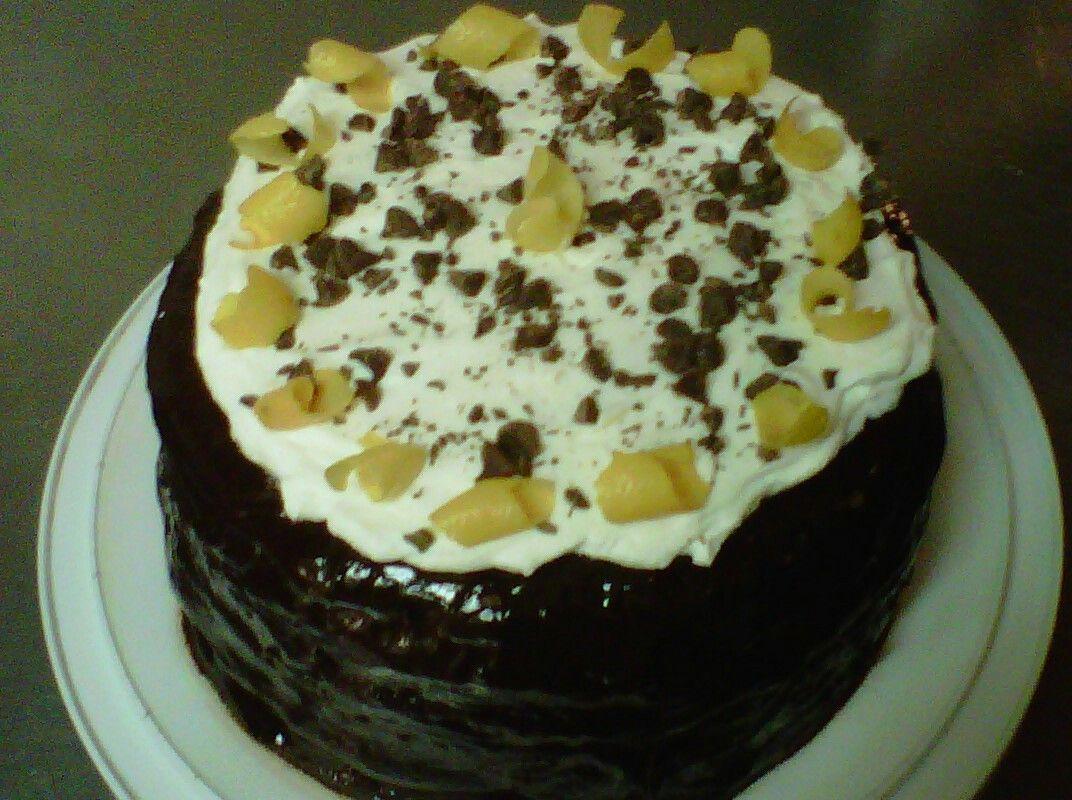 Cannoli cream cake with dark chocolate ganache and zest