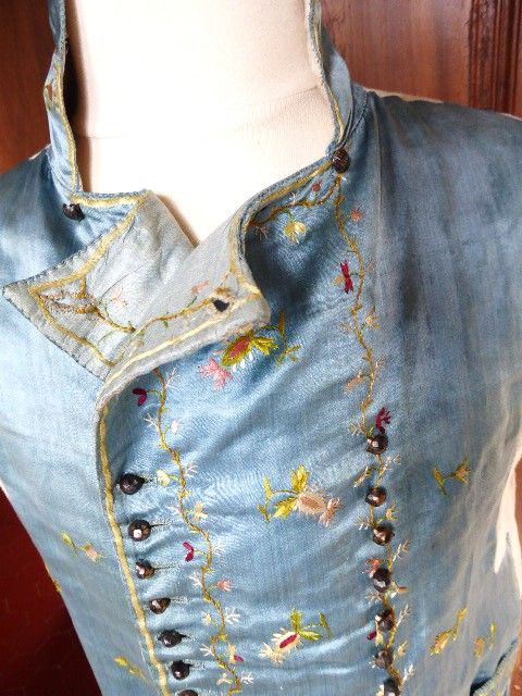 Double-breasted waistcoat, France, 1795-1805.Nattier blue silk satin, embroidered with multicoloured floral sprays, linen lining.