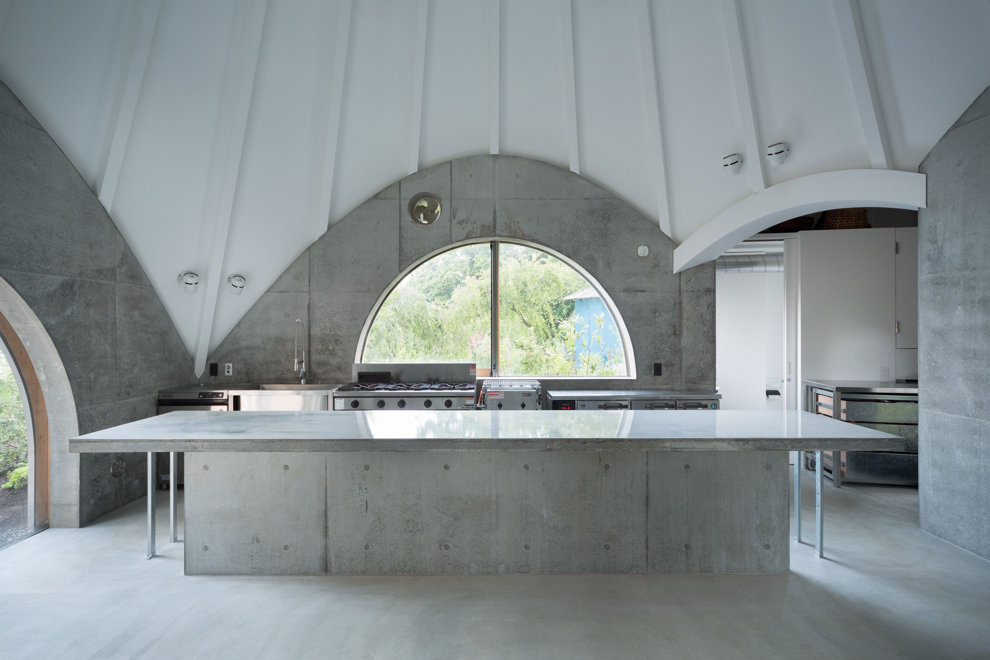 Teepee-shaped Jikka complex by Issei Suma features community kitchen and…