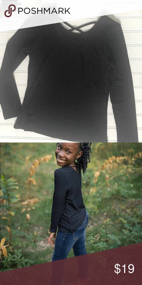 5ad87818fc2925 Girls black cross back long sleeve top Solid black - ribbed fabric. Super  soft! Cross on the back of shirt. Fits true to size. Peyton Bre Shirts &  Tops Tees ...
