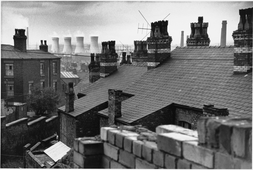 Cooling towers through the rooftops, Salford, 1962