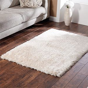 White Shag Rug On A Wood Floor White Bedroom Orange Accent