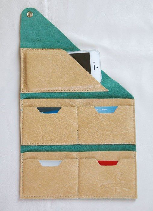 The Wrap Wallet. Could probably make this out of fabric - 2 large pockets hold your many benjamins and 4 small pockets hold up to about 16 credit cards. The extra smaller pocket fits an iPhone 4 without a case.