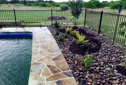 Oklahoma flagstone around pool with arizona river rock for Az pond and pool