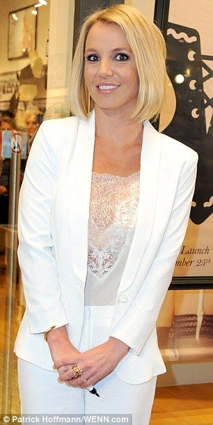 Making the cut: Britney showed off a sleek new bob as she greeted fans at the shopping mall. Wow .. she actually looks like a responsible adult