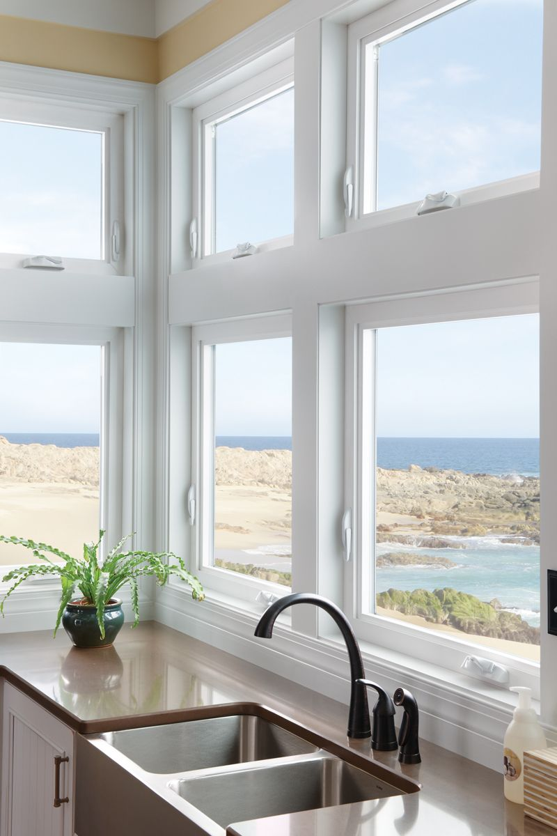 Kitchen in beach home. Milgard Tuscany® Series vinyl windows. Photo ...