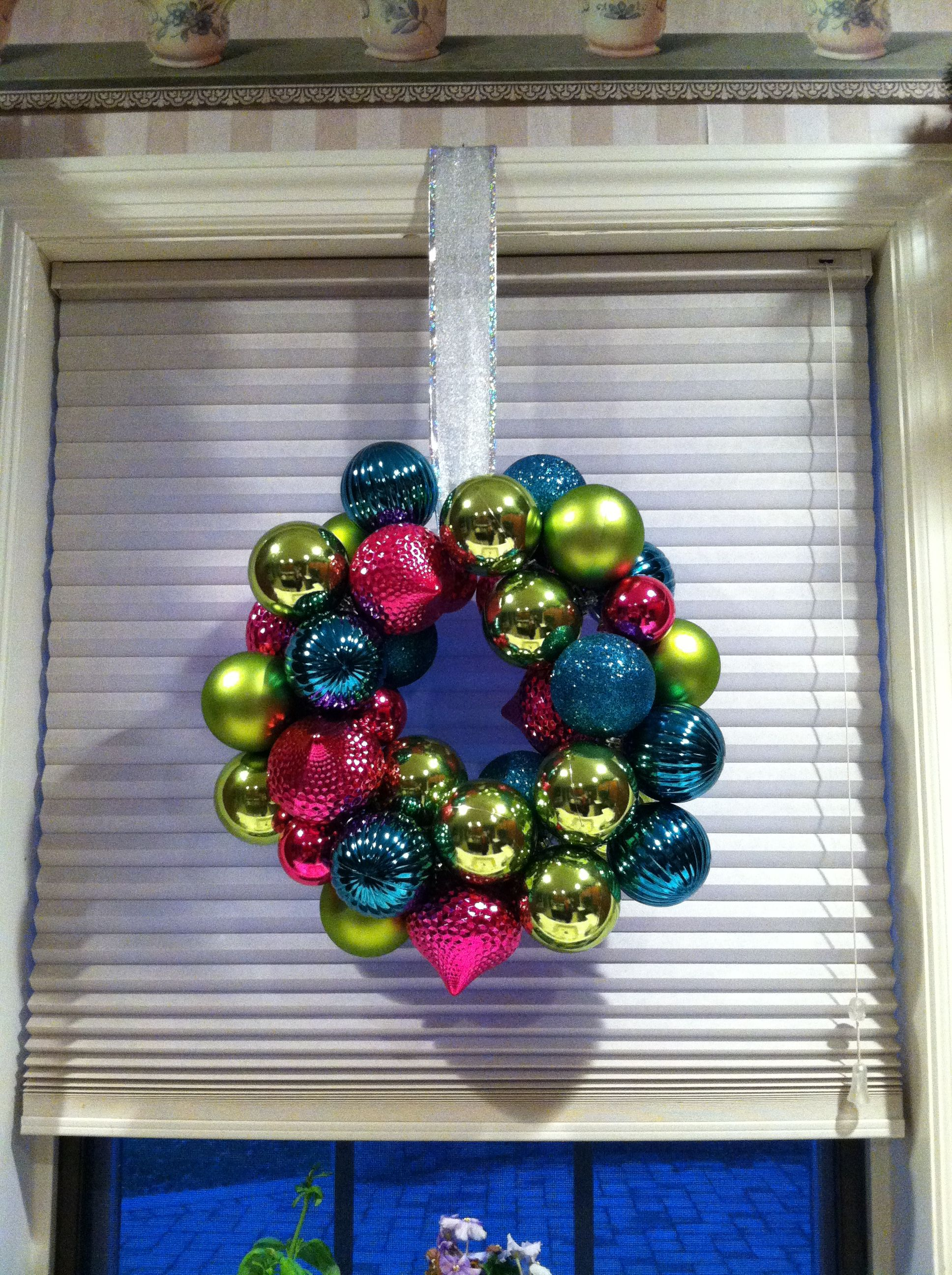 Ornament wreath made on wire hanger. 10 minute craft