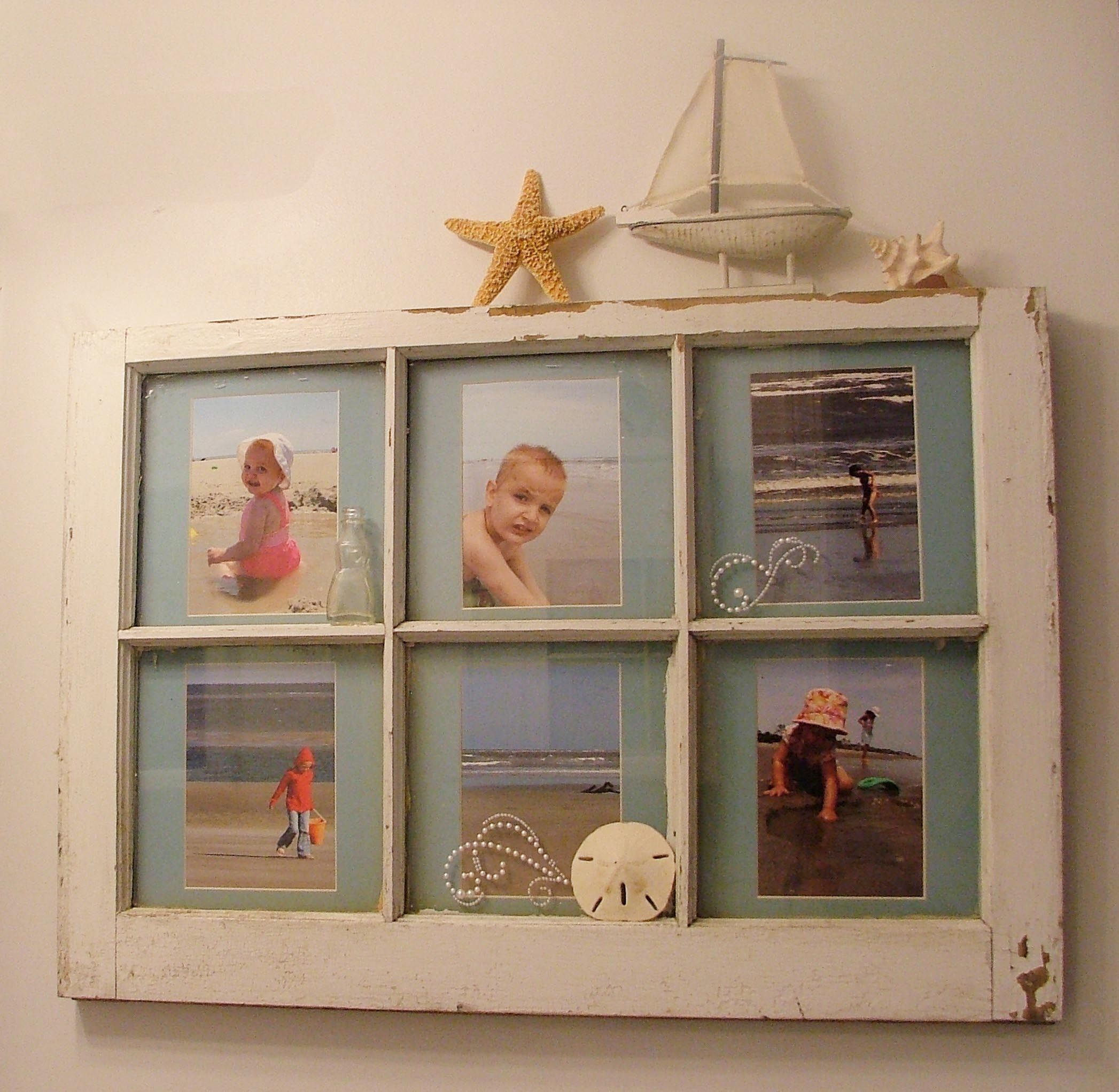 """I made this for my """"beach"""" themed bathroom out of an old window and a picture of each of my 5 kids (the sixth window pane is just the beach.)   It was fun!  :)"""