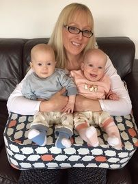 These twins are 6 months old, well done super mummy ...