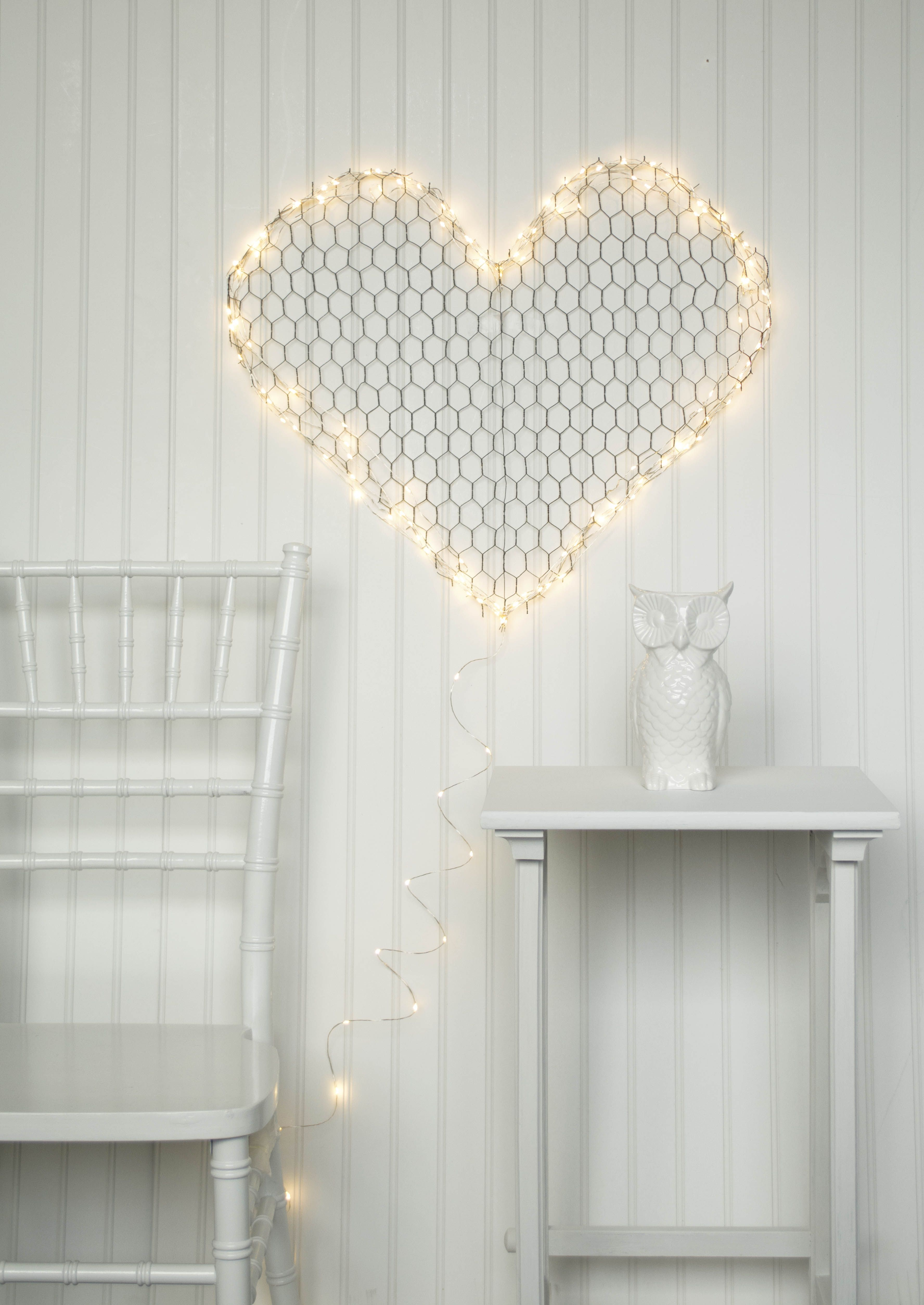 Create You Own Fantastical Light Sconces By Simply Wrapping Chicken Wire Forms In Extra Long Fairy Light Strands H Fairy Lights Led Fairy Lights Chicken Wire