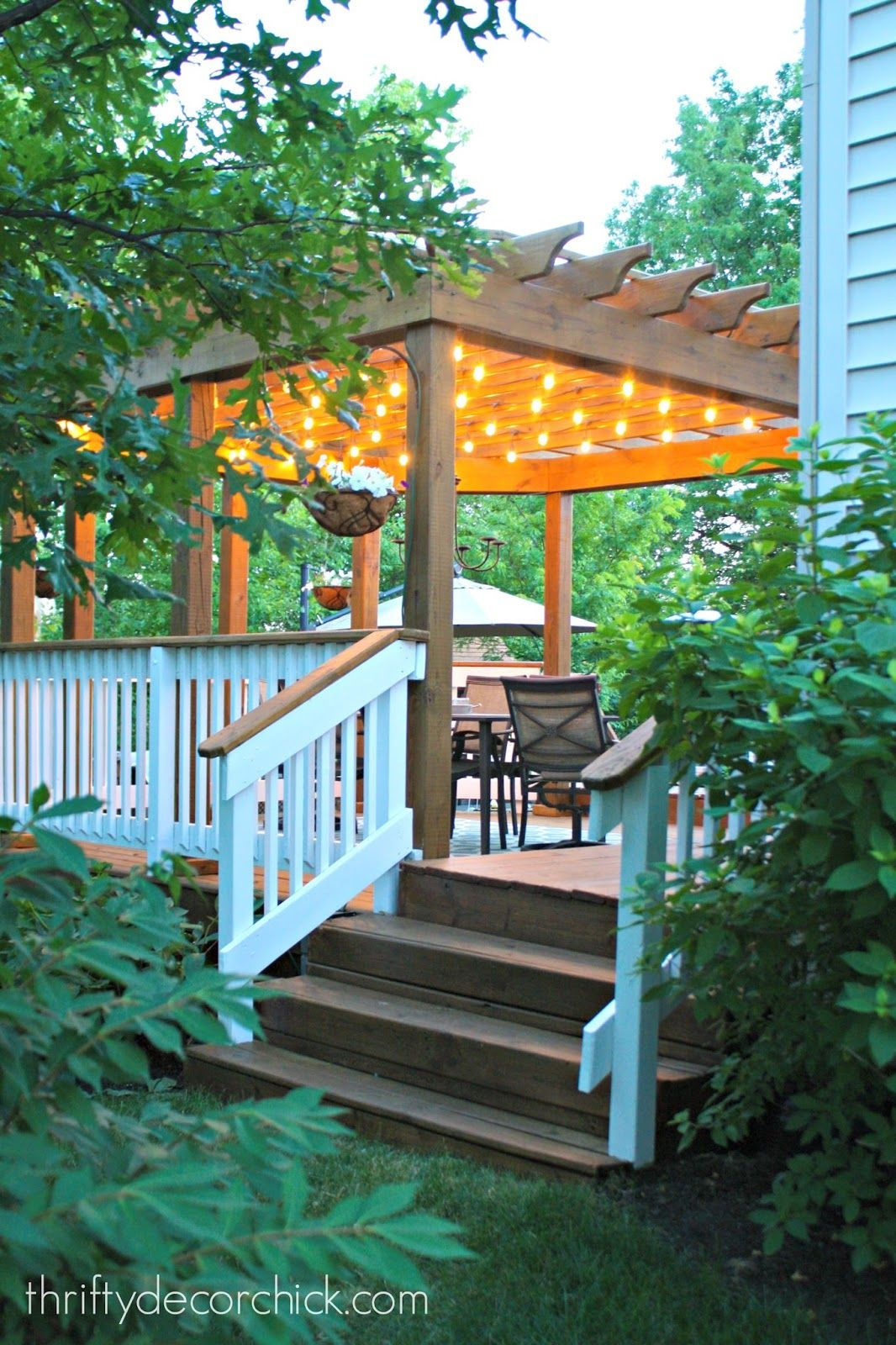 How to hang outdoor string lights from Thrifty Decor Chick