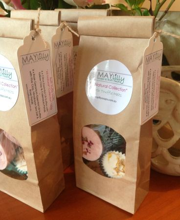 Maylilly Soaps All natural bath truffle melts, all packaged up in a kraft brown tin tie bag.
