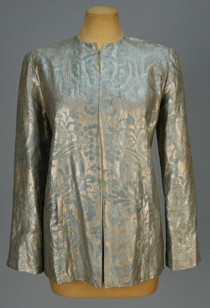 *     MARIANO FORTUNY STENCILED EVENING JACKET, c. 1940 Collarless blue cotton twill with silver stenciled pattern, vertical pockets, silk lining and weighted hem