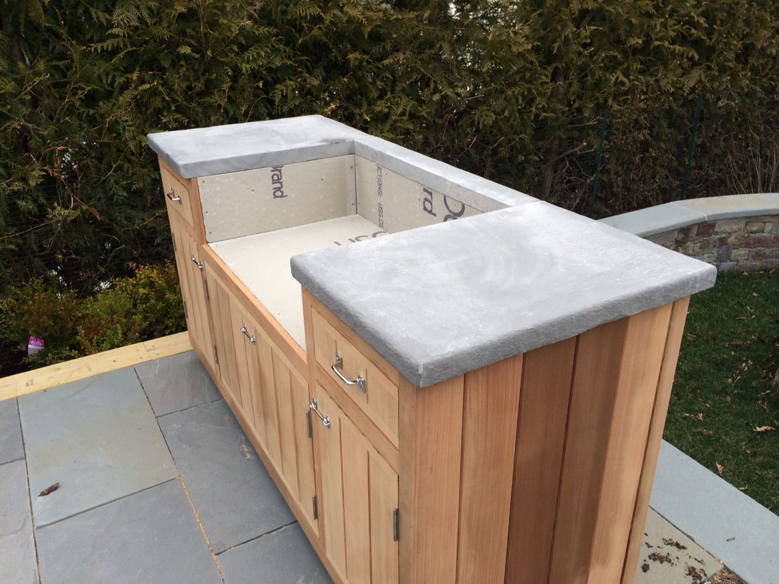 Outdoor grill countertop made out of 2 thermalled for Cedar outdoor kitchen cabinets