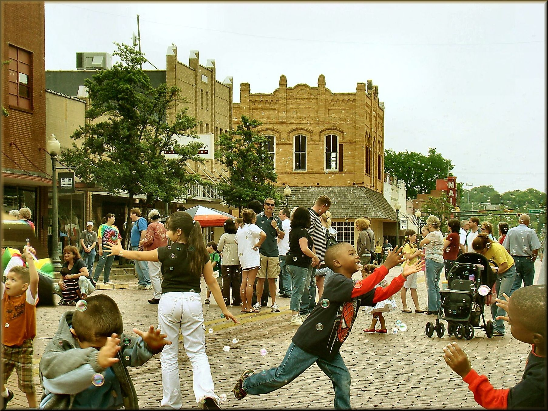 Chasing bubbles at the multicultural festival in historic