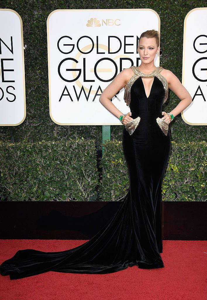 Blake Lively was stunning in a custom-made, Atelier Versace gown in occasion of the 2017 #GoldenGlobes. She wore a black velvet gown with chainmail accents encrusted with Swarovski crystals, cut-out detail at the bust, and elegant train.