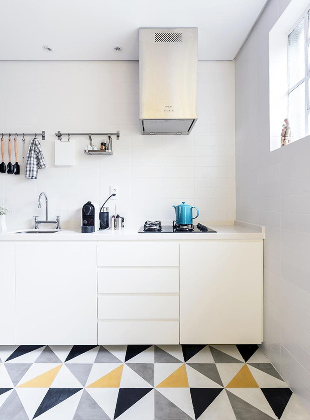 While we love a good, all-white kitchen as much as the next blog, there's something about a little unexpected bright color, an earthy texture, or some quirky accessorizing that stands out from the pack of conventionally beautiful designs. In the same carefree, adventurous spirit as the summer season, these 10 designs feature a warm, inviting cheer courtesy of their vibrant florals, dusty solids, rustic finishes, energizing accents, and even a vegetable metaphor or two. We can only imagine…