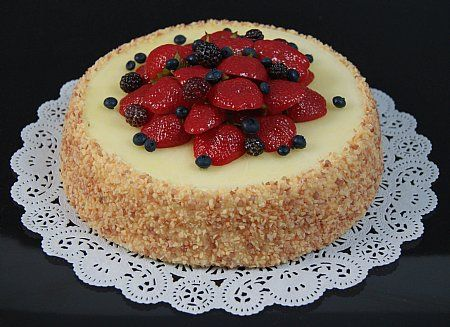 Display Fake Food's Cheesecake with Berries. Mixed berries top this New York style cheesecake - a great fraud.  9 inches x 4 inches