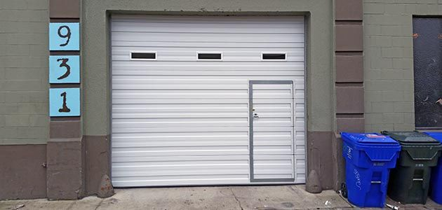 doors pedestrian over wicket steel up fort garage door a and with smartpass