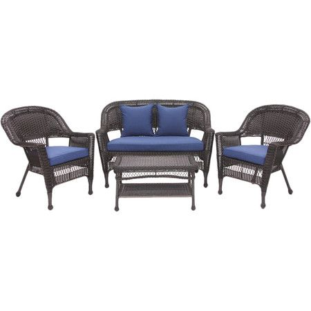 Equip your patio for outdoor soirees and family barbeques with this wicker-inspired seating group, featuring navy blue cushions for a pop of color.