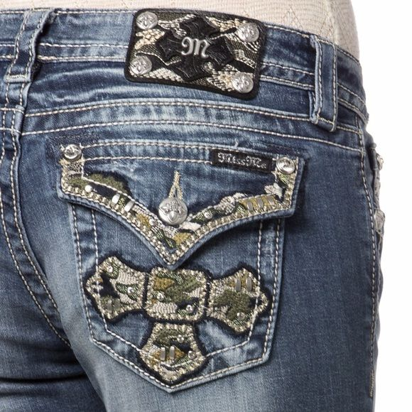 NWT Miss Me Cam Shimmer Cross Bootcut Jeans Stand out from the other glamour girls in these shimmery camo cross boot cut jeans! These designer Miss Me jeans are detailed with an embellished camo cross on back flap pocket, distressing at front with fading and whiskering. Miss Me Jeans Boot Cut