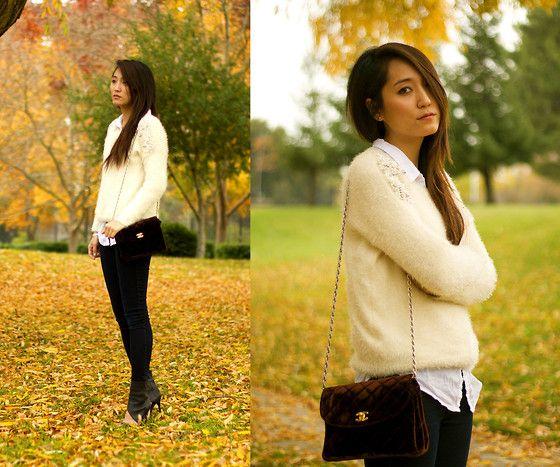 Fur sweater over white buttondowns