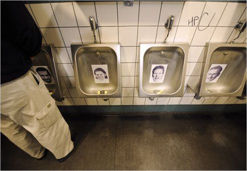 Photographs of bankers who left Iceland after the financial crisis have a new use in the restroom of a bar in Reykjavik, the capital.
