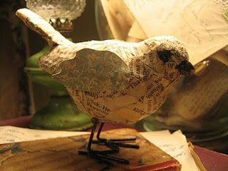 Newspaper covered $ store bird.  Cute and Cheap!