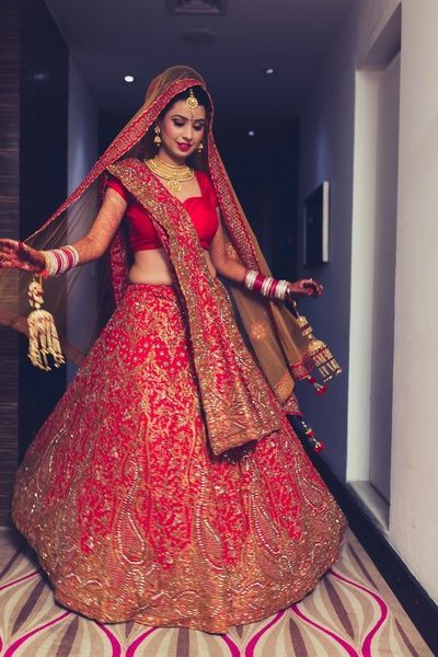 Pair This Red And Gold Bridal Lehenga Covered With Beautiful Rich Zardozi Art Work An Intricate Bib Styled Necklace Set Crafted Studded