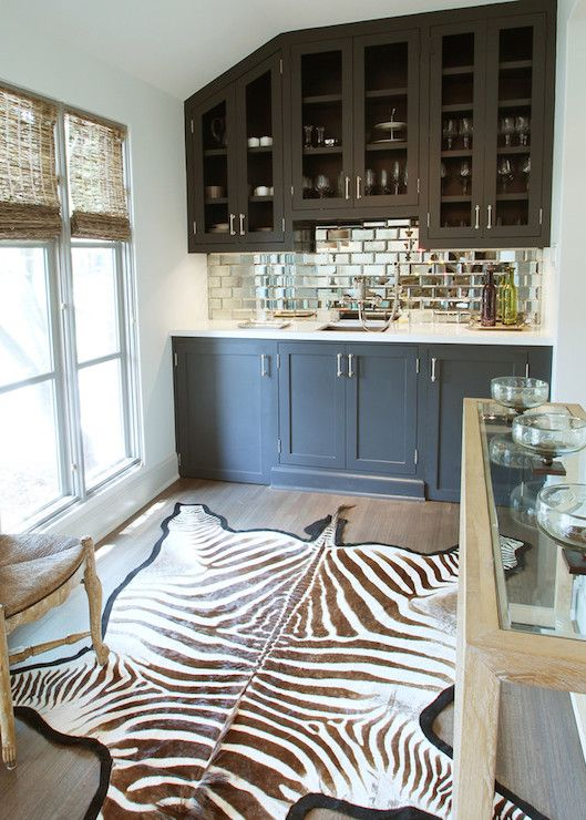 Wet Bar With Mirrored Tile Backsplash And Zebra Rug Marie