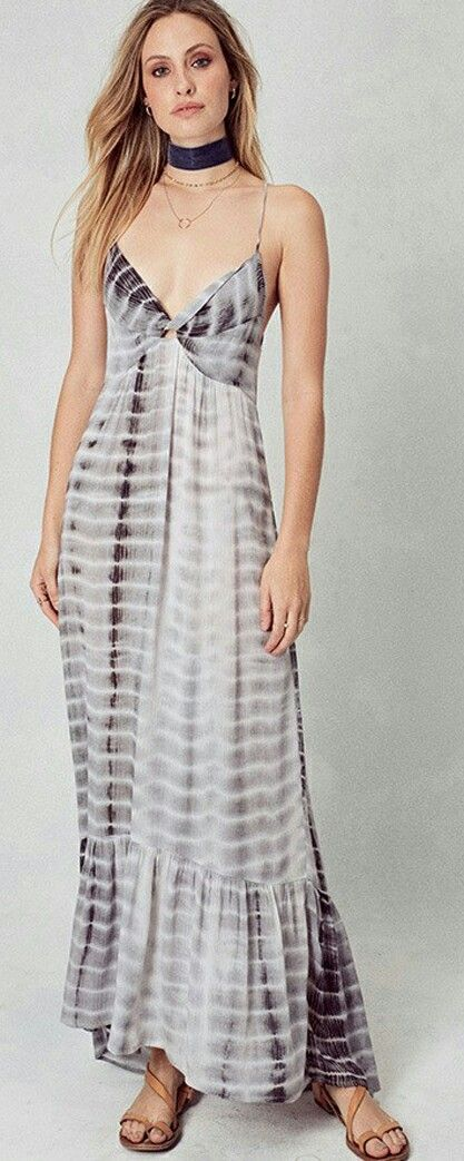 Tye/dye maxi dress with cut-out back. 100% Rayon. Available in blue only!
