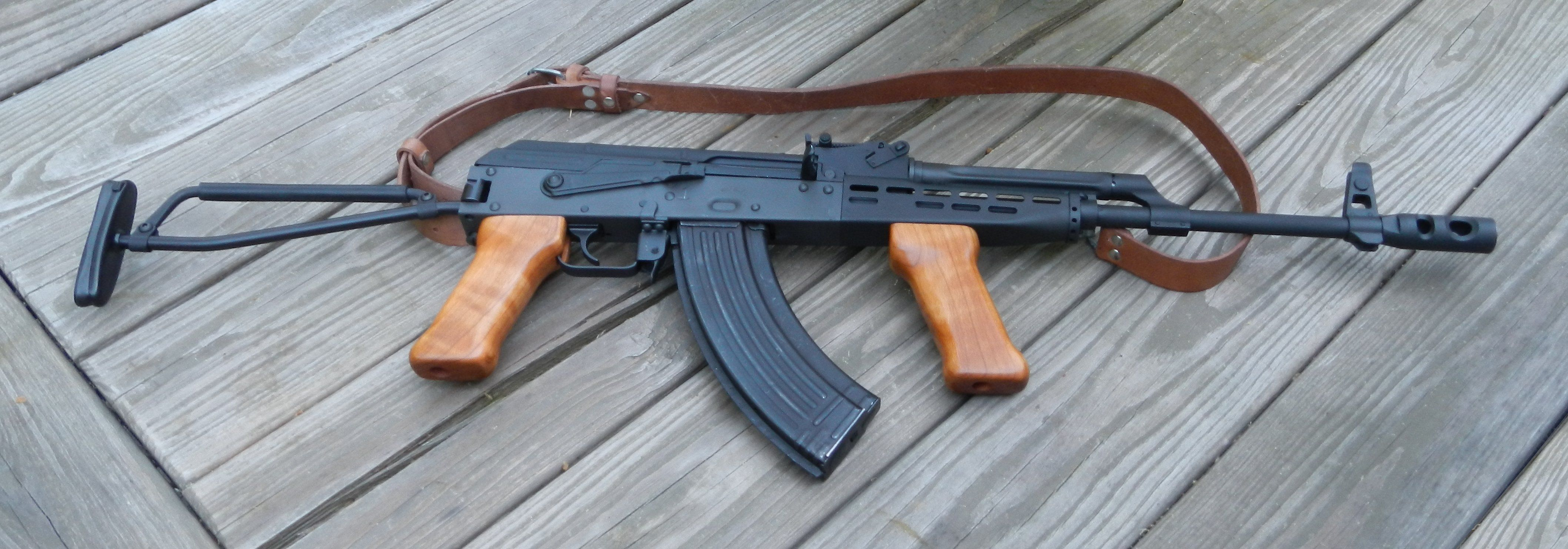 Hungarian AMD-65 with cheek riser and cherry grips added