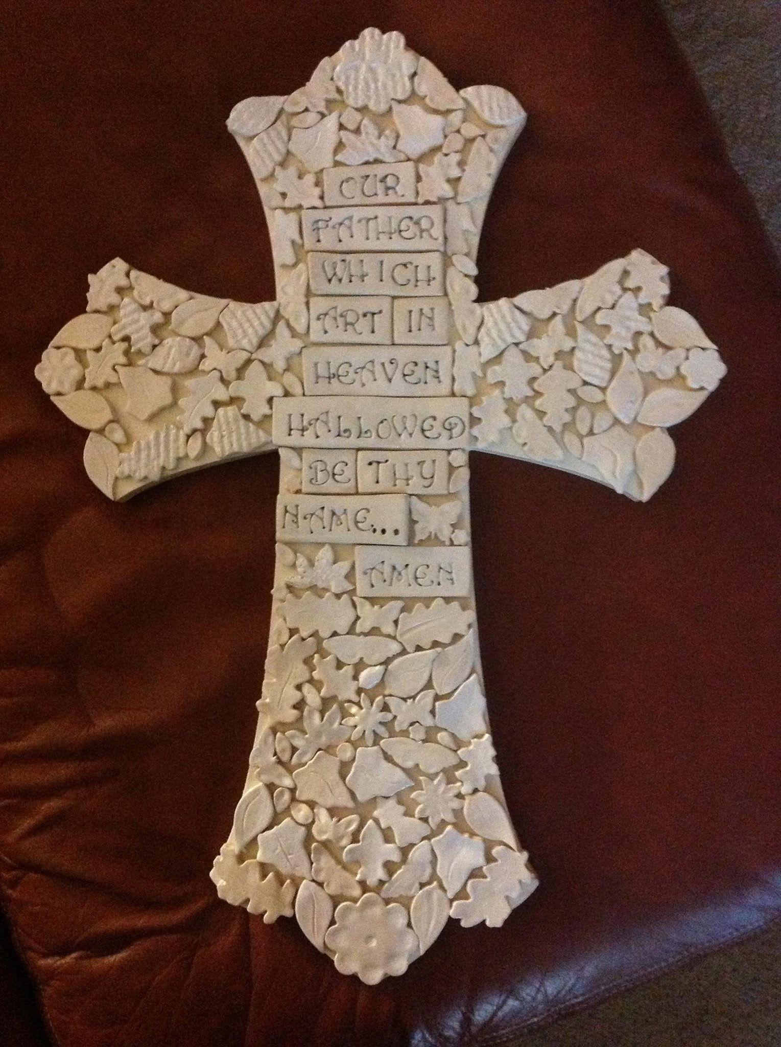 Handmade stoneware tiles on a wooden cross