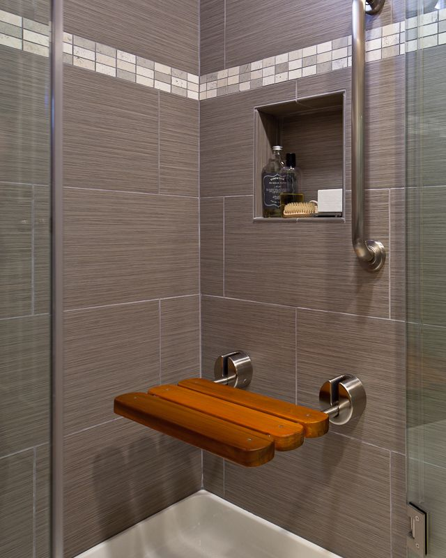 I love the idea of a shower bench that will fold up out of the way ...