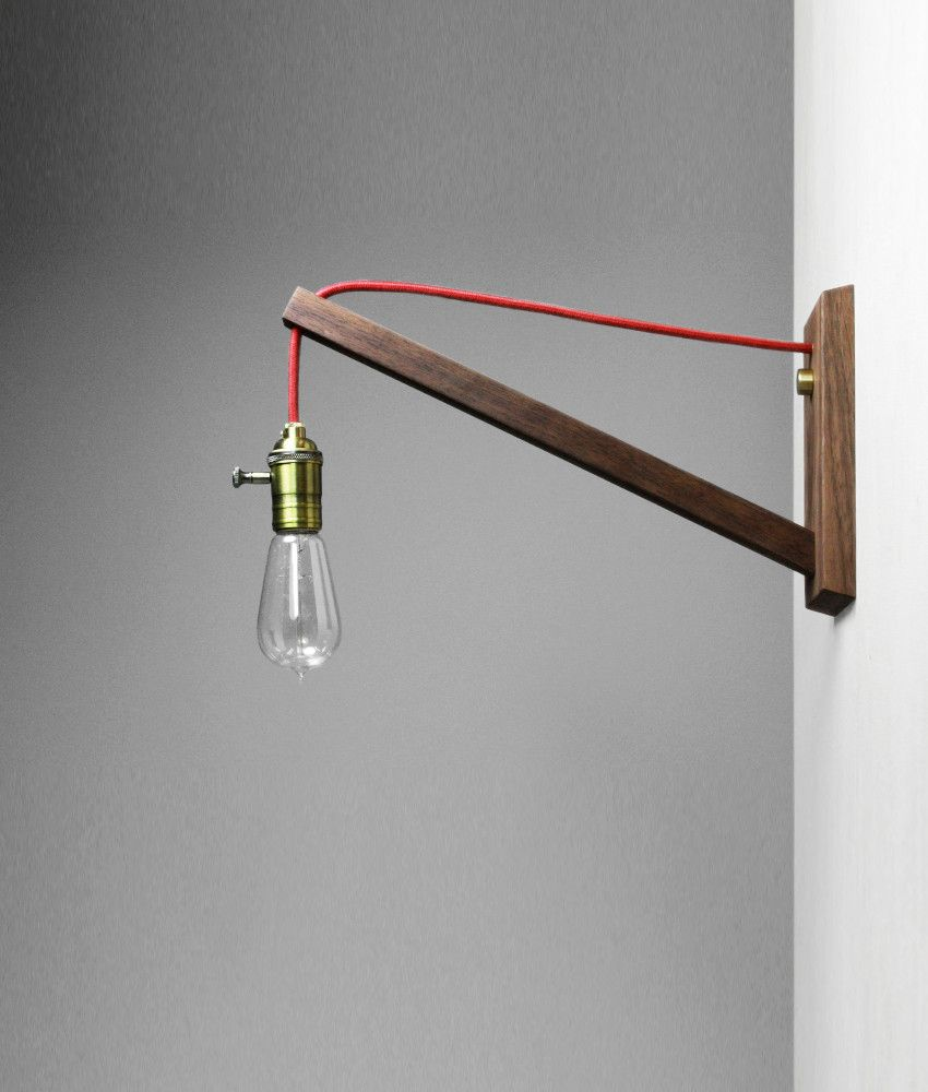 Simple wall lamp solution? Decorative bulb, red cord, wooden bracket? Think there is an Ikea ...