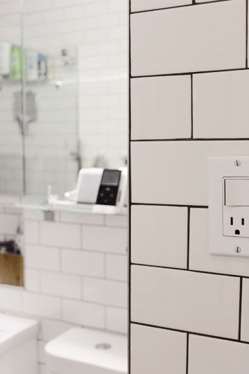 black grout trendy bathroom tiles