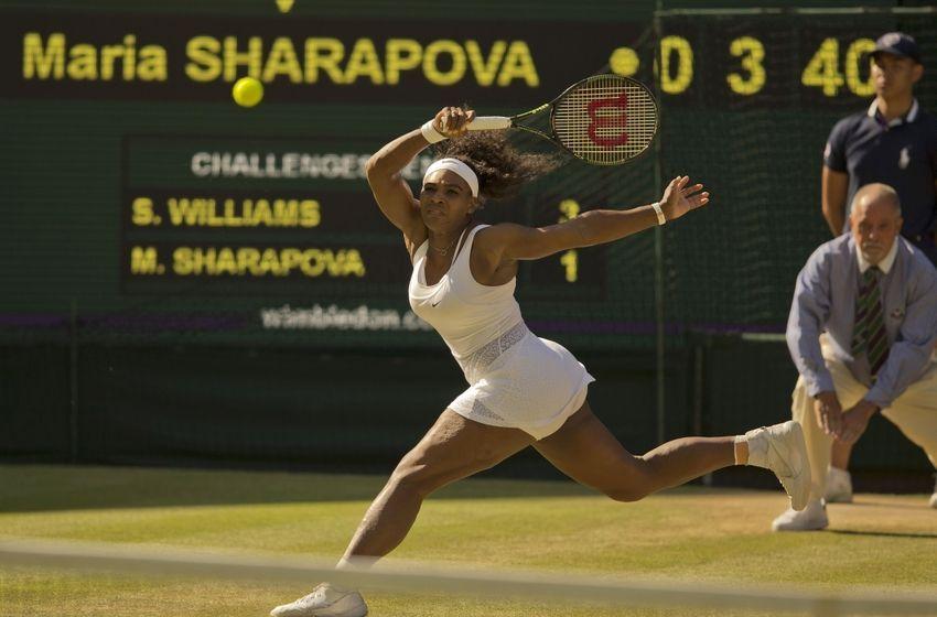 Serena Williams returns to Maria Sharapova in the Semifinals of Wimbledon 2015.