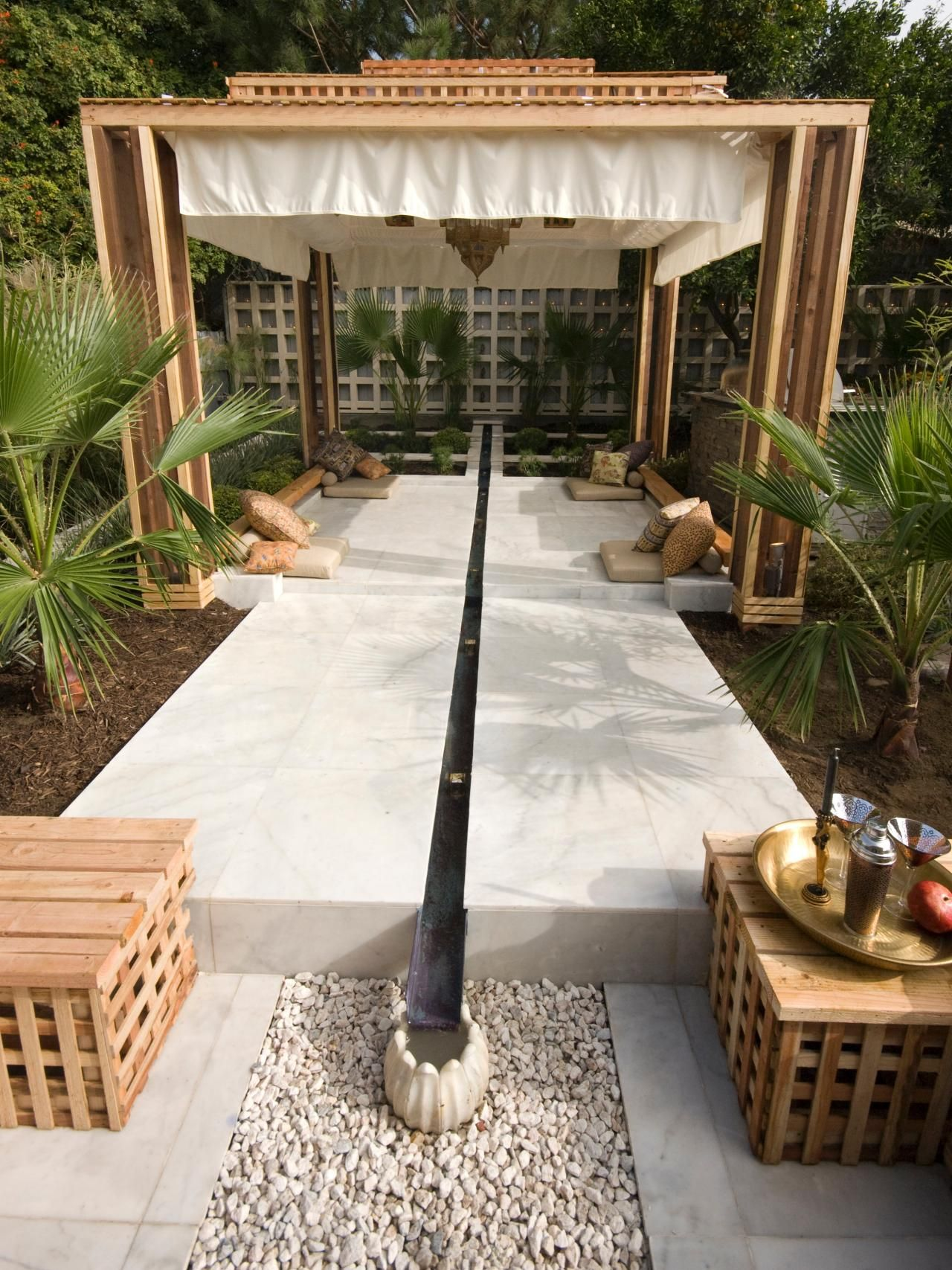 the egyptian style water feature continues across the backyard and