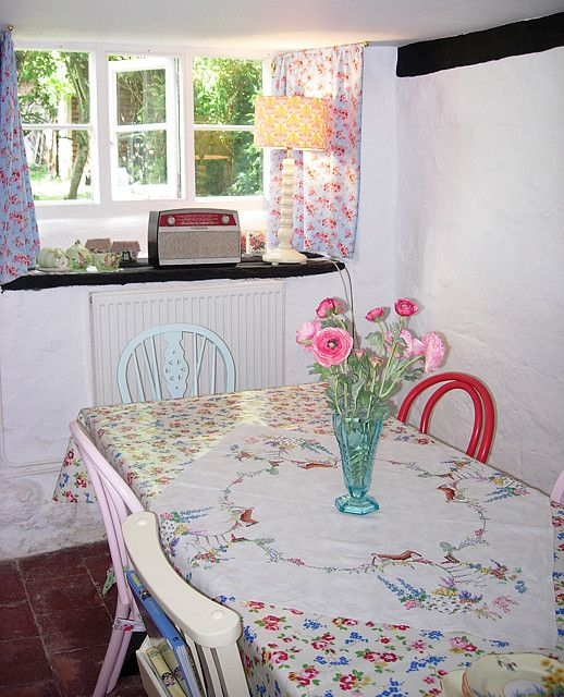 country cottage kitchen - love the mismatched chairs