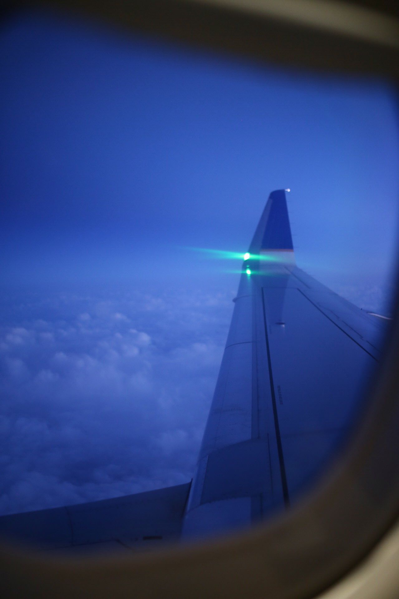 Night Time Shot From The Window Seat With Rich Blue Skies