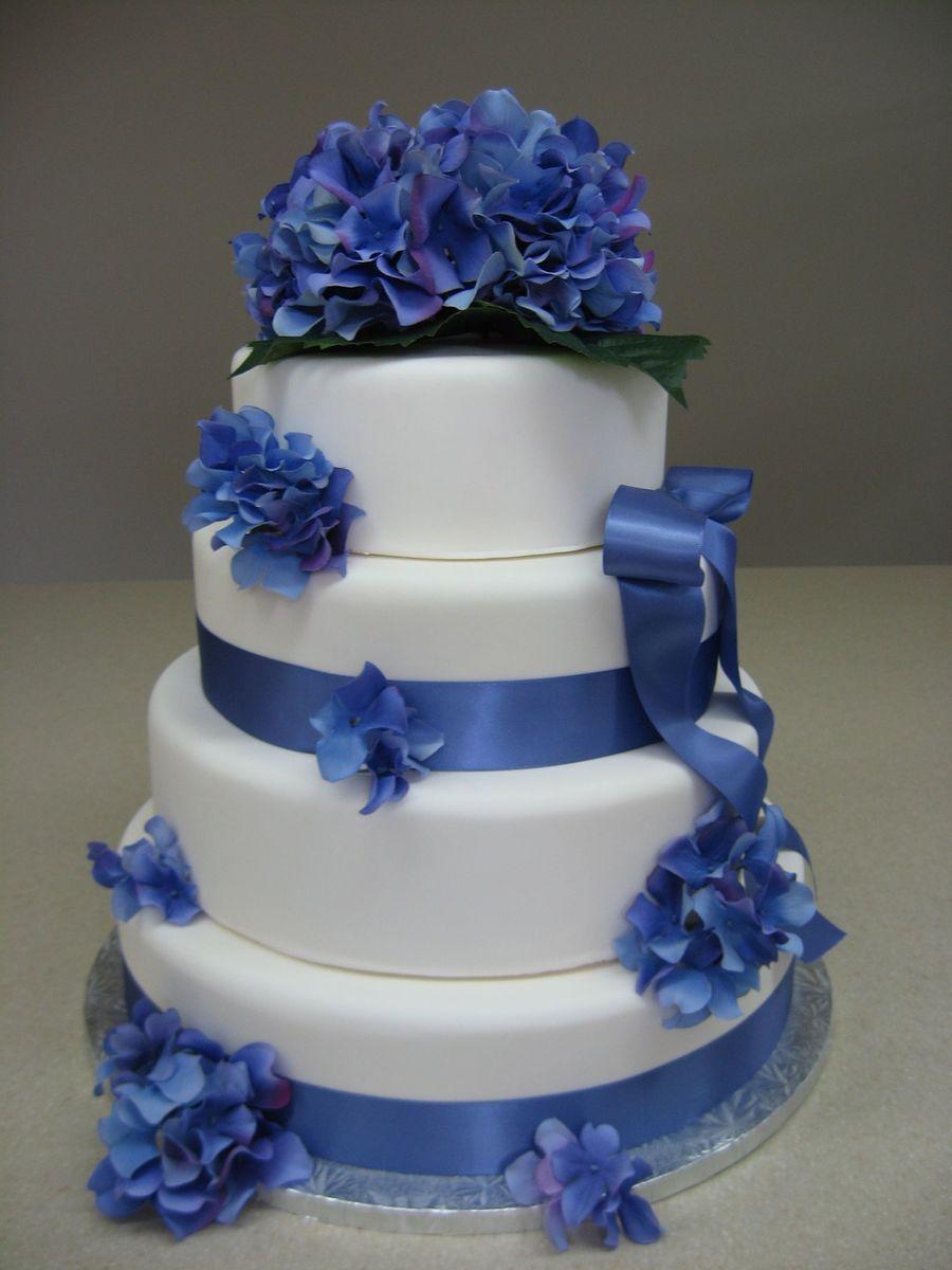 Blue beauty blue spring hydrangeaus adorn this wedding cake dorty