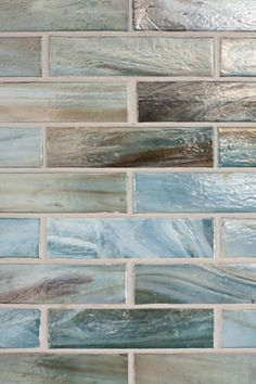 In This Coastal Kitchen Iridescent Quartz Subway Tiles Are
