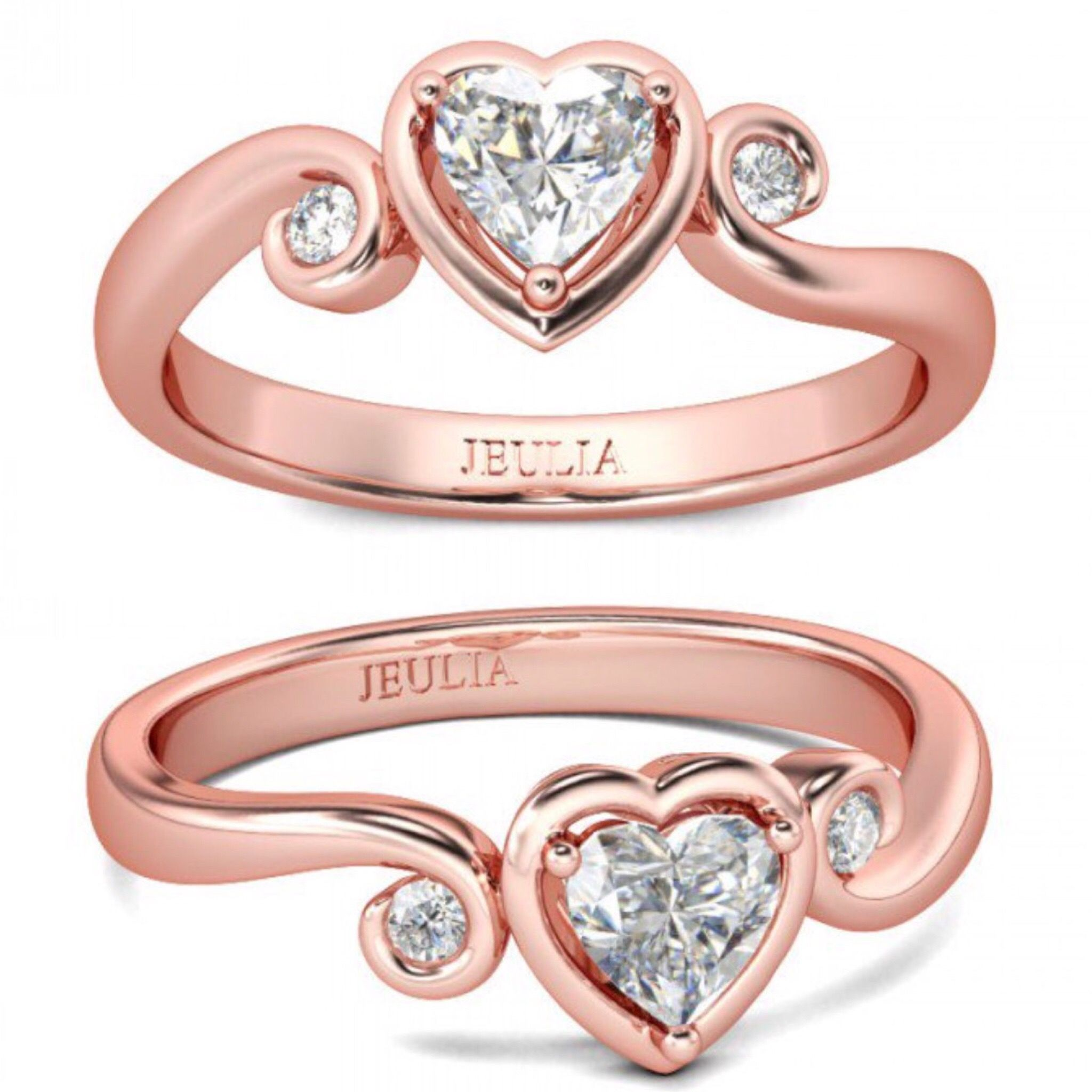 This romantic engagement ring features a heart shaped created white ...