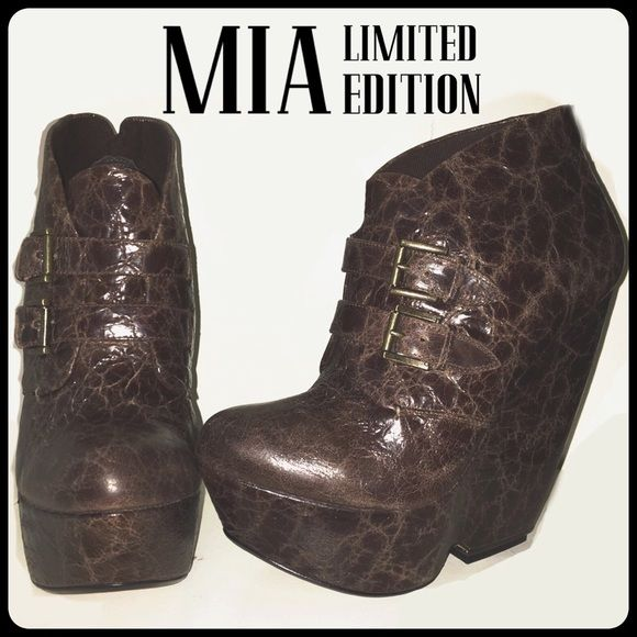 """MIA Limited Edition (MLE)Veda Wedge Bootie NIB 7.5 MLE (Mia Limited Edition) Veda Wedge Bootie might just be THE perfect boot for the season. MLE is the more upscale companion to the MIA shoe brand and its a fantastic label for who do not want to sacrifice comfort, style, and quality. This particular must-have features a distressed leather upper, dual buckle closures, a wrapped 5 3/4"""" wedge heel with 1 3/4"""" platform MSRP $179  new in box ..size 8 MIA Shoes"""