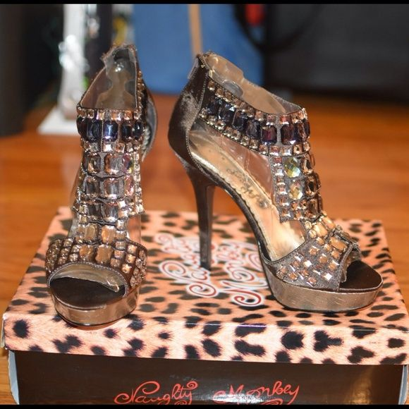 Beautiful designer shoe by Naughty Money This shoe is brown/ taupe color with beautiful embellishments throughout the shoe. Size 8.5 NO TRADES naughty monkey Shoes