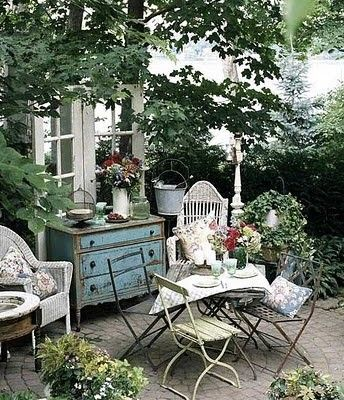 Found objects & flea market bargains make for charming patio ...