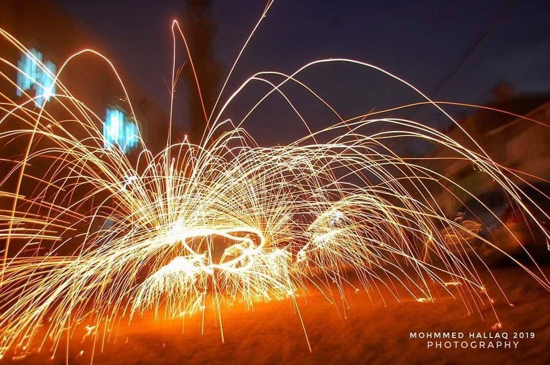 من طقوس رمضان بعد الإفطار أطفال يشعلون سلكة الجلي في مدينة غزة مساء اليوم تصوير محمد الحلاق Flowers Plants Dandelion