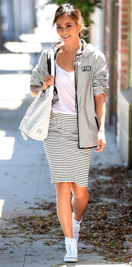 7ed607051f3d Jamie Chung took on the athleisure trend with a white tee and striped  pencil skirt.