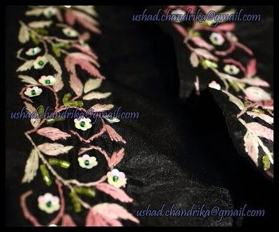 Black silk Saree with embroidered border in Satin stich in pink with beadwork & sequins. Same work on blouse piece too.